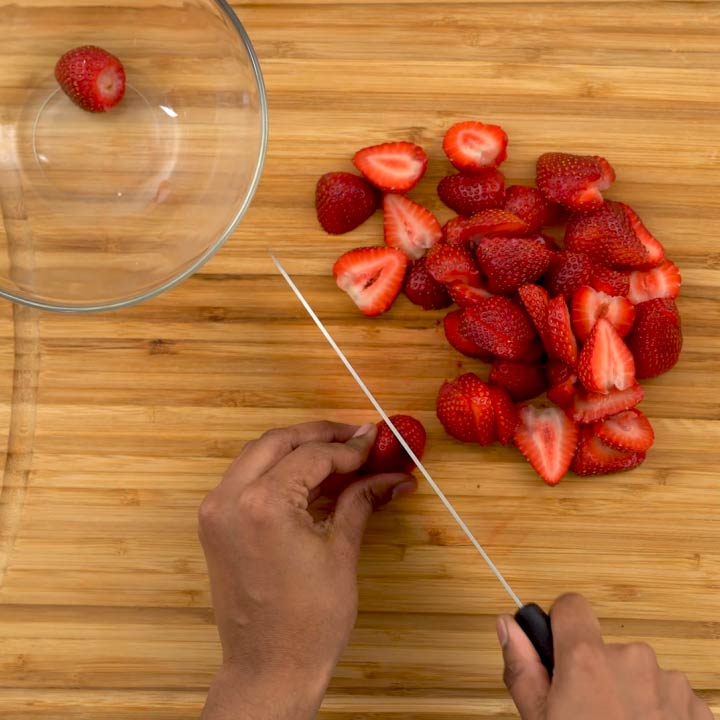 cutting strawberries into pieces