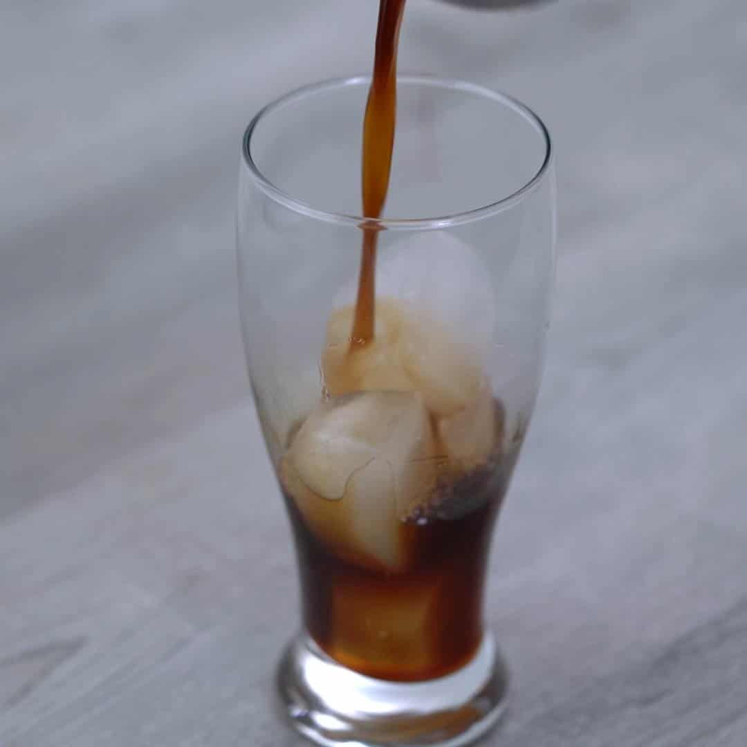 pouring chilled coffee over ice
