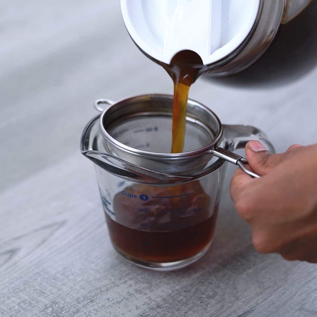filtering cold brew coffee concentrate